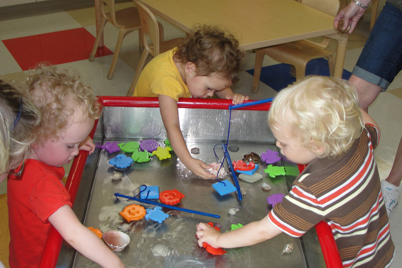 toddlers playing in water area